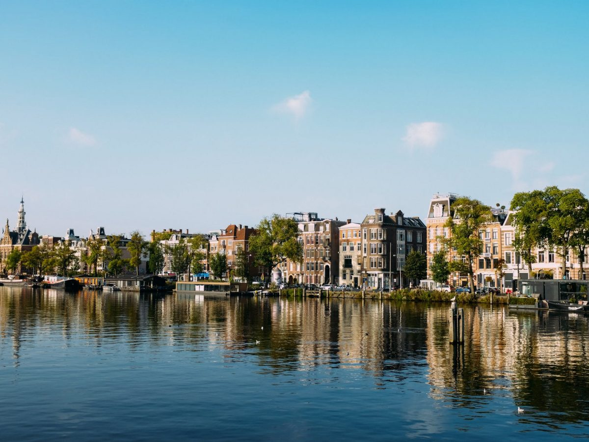 old city district on river bank on sunny day
